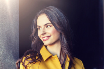 summer, leisure, vacation and people concept - smiling young woman in city