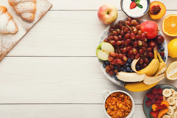 Fresh healthy breakfast with fruits copy space