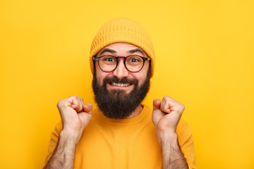 Cheerful excited hipster man