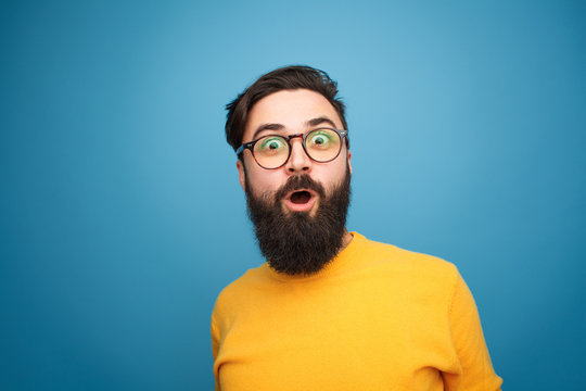 Super excited bearded hipster looking at camera