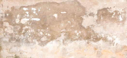Old empty dirty plaster wall with cracked structure as background.