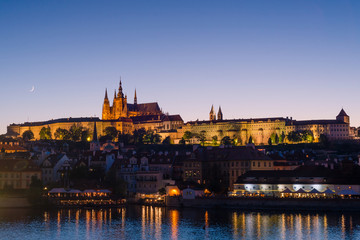 Prague, Bohemia, Czech Republic. Hradcany is the Praha Castle with churches, chapels, halls and towers. Evening view of the tourist attraction.