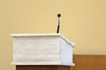 Rostrum with microphone in conference hall or church altar