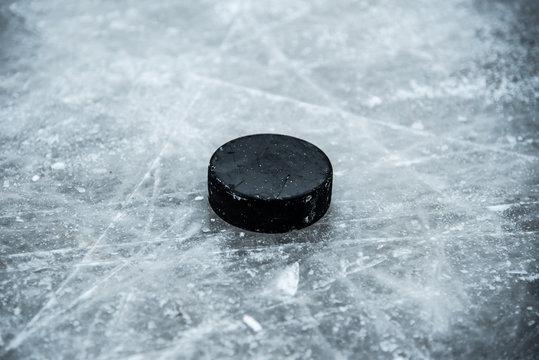 hockey puck lies on the snow close-up