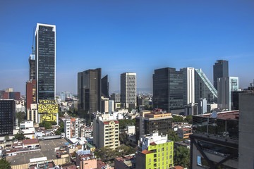 Fototapete - Skyline in Mexico City, aerial view of the city