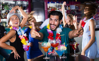 male is having fun on the hawaiian party