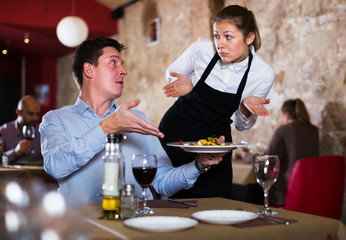 Dissatisfied man in restaurant