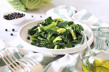 Vegetarian cuisine: fried cabbage with juniper berries and olive oil
