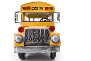 Toy school bus isolated on white