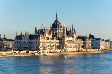 Famous Budapest parliament at the river Danube during sunset from the side