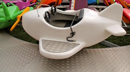 A Childrens Aeroplane Fun Fair Amusement Ride.