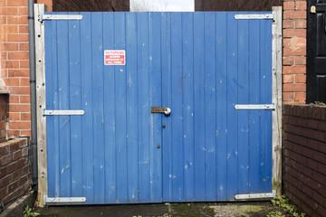 Locked blue wooden gate