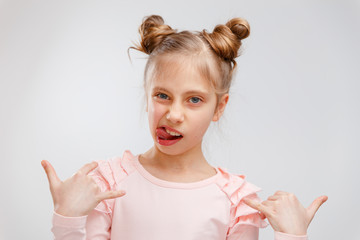 The dissatisfied girl frowns, has an ugly expression, expresses non-compliance, irritates someone, refuses to do something. People and negative facial expressions