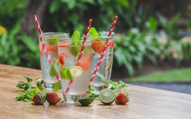 Fresh lemonade or mojito with paper straws. Stop plastic concept