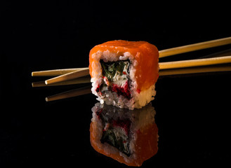 Rainbow Sushi Roll with salmon, eel, tuna, avocado, royal prawn, cream cheese Philadelphia, caviar tobica, chuka. Sushi menu Japanese food