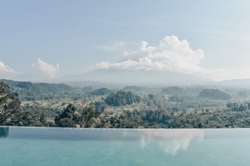 beautiful view on fantastic volcano Agung in Bali from swimming pool