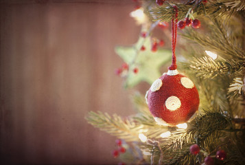 Eco friendly holiday Christmas tree, natural ornaments and wood background
