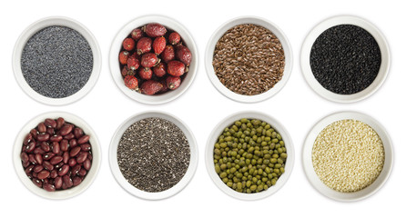 Set of superfood isolated on white background. Superfood with copy space for text. Seeds of flax, poppies, beans, mung beans, chia, sesame and rosehip. Top view.