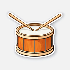 Sticker of classic wooden drum with drumsticks
