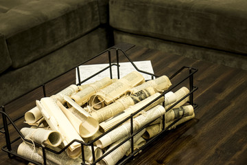 Vintage newspapers rolled up on the wooden table
