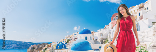 Wall mural Europe summer vacation luxury tourist Asian woman walking in Oia city street, Santorini, Greece. Popular european honeymoon destination and cruise travel. Banner panorama.