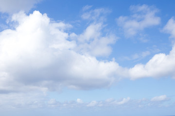 blue sky background with white big clouds