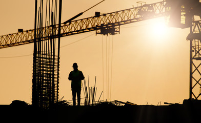 Silhouette of engineer at construction site