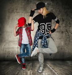Mother and son dance hip-hop.Urban lifestyle. Hip-hop generation.