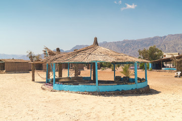 Straw huts on beach during daytime, Nuweiba, Southern Sinai, Egypt