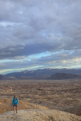 Adult woman hiking in badlands section of Anza Borrego State Park, California, USA