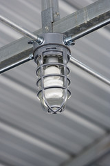 Light bulb in metal building.
