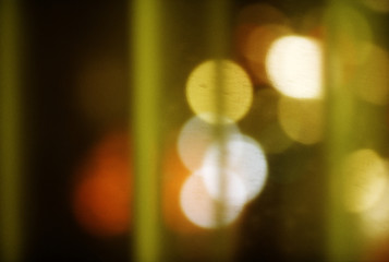 Aperture lens flare of colored lights.