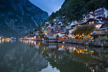 Illuminated city on coastline at night, Hallstatt, Upper Austria, Austria
