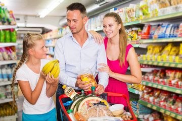 Family standing with purchases