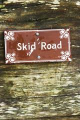 Skid Road sign on wood.