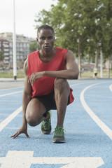 Portrait of athlete on running track, Barcelona, Catalonia, Spain