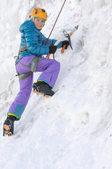 Portrait of young girl ice climbing at kids wall, Ouray Ice Park, Ouray, Colorado