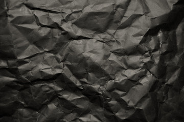 Blank crumpled black paper