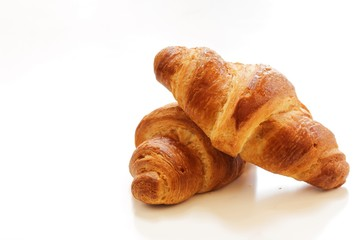 Homemade French Croissants isolated on white, selective focus