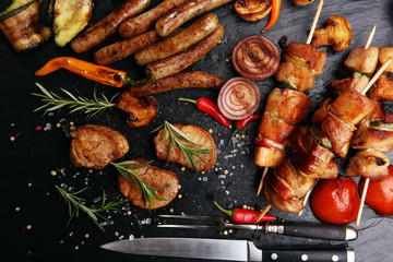 Photo Stands Grill / Barbecue Assorted delicious grilled meat with vegetable on a barbecue
