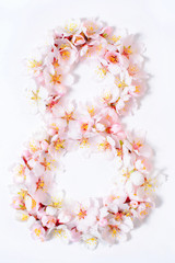 Arabic numeral eight lined with flowers on a white background