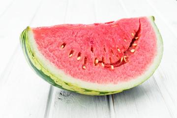 half watermelon on white wooden board