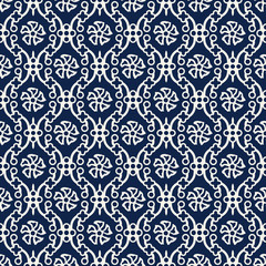 Indigo dye woodblock printed seamless ethnic floral damask pattern. Traditional oriental ornament of India Kashmir, flowers on ogee molding,  ecru on navy blue background. Textile design.