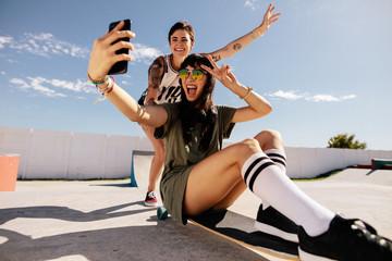 Girls skateboarding and taking selfie