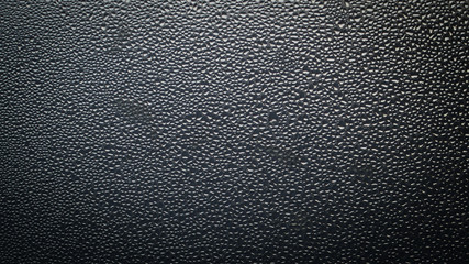 Water drops texture on glass. Abstract minimalistic background for your design. Neutral tone pattern. Aspect ratio 16:9