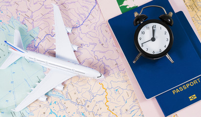 passport and airplane on the map