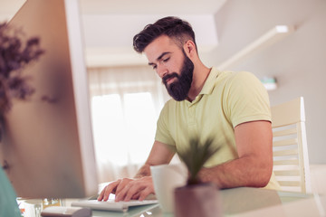 Man working from home on computer