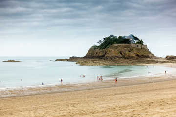Tourists on beach, Brittany, France, Europe