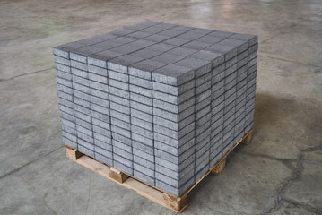 Concrete road curbs at the factory for the production of cement products, paving slabs