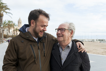 Smiling father and son in city